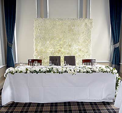 Artificial wedding flowers hire rose table runner
